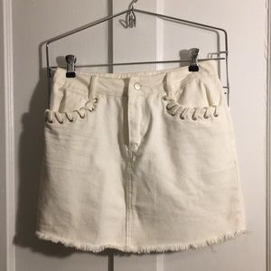 White denim skirt with shoelace detail on pockets